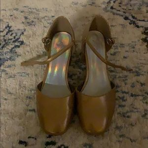 Gold urban outfitters Mary Jane heels.